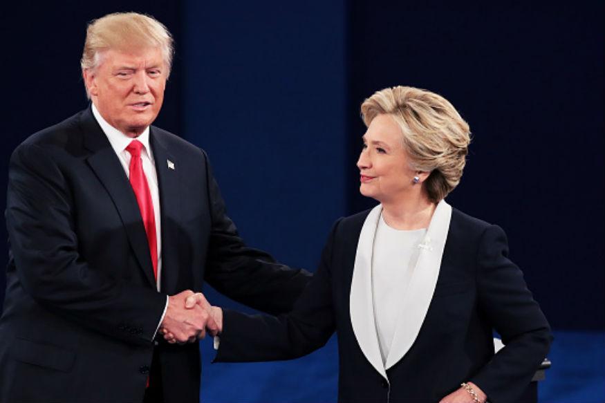 握手を交わすクリントン氏とトランプ氏