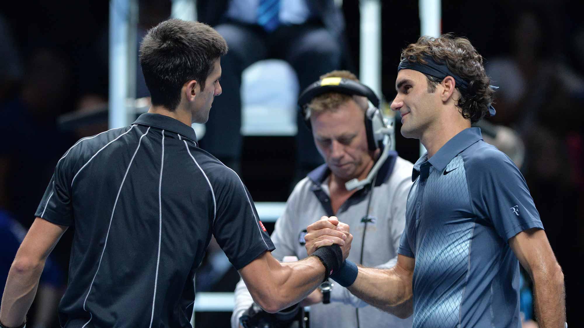 Novak Djokovic and Roger Federer shaking hands at World Tour Finals