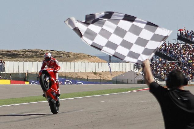 MotoGP Racer with Checkered Flag